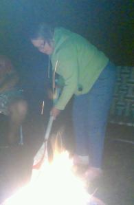 Tradition: sitting around the campfire sharing stories and laiughter. Tam had fun keeping the flames going.