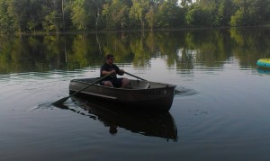 Tim loved fishing from the row boat at the cottage.