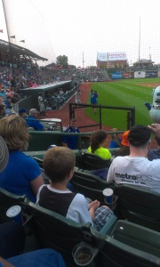 Attending the SouthBend Cubs where Wesley interns. We had superb seats behind home plate. Wes was nearby in the tunnel ready to take care of official business.