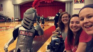 Elizabeth hanging out with her roommate and friend at the men's basketball game. Go Lancers!