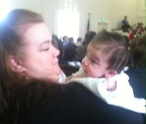 My sister-in-law adoring her grandson. Look at all of his hair!