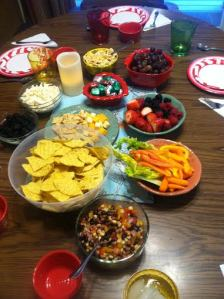 Tam adds colorful snacks to the table. That table holds many stories and laughter.